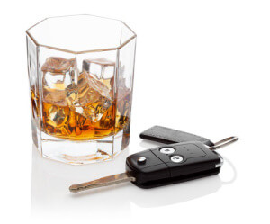 Glass of whiskey and car keys, isolated on the white background, clipping path included.